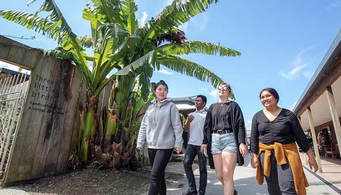 University of Waikato students visiting Raglan beach